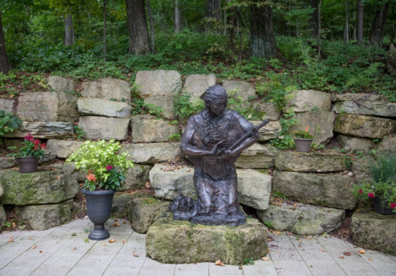Bronze statue of Saint Kateri Tekakwitha, Lily of the Mohawks, by artist Cynthia Hitschler, at the Shrine of Our Lady of Guadalupe in La Crosse, Wisconsin